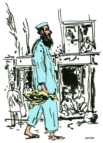 homme marchant avec son poulet dans une rue commerçante de Peshawar au Pakistan
